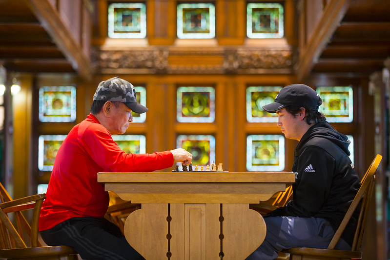 Two men playing chess in the Aiken Ell